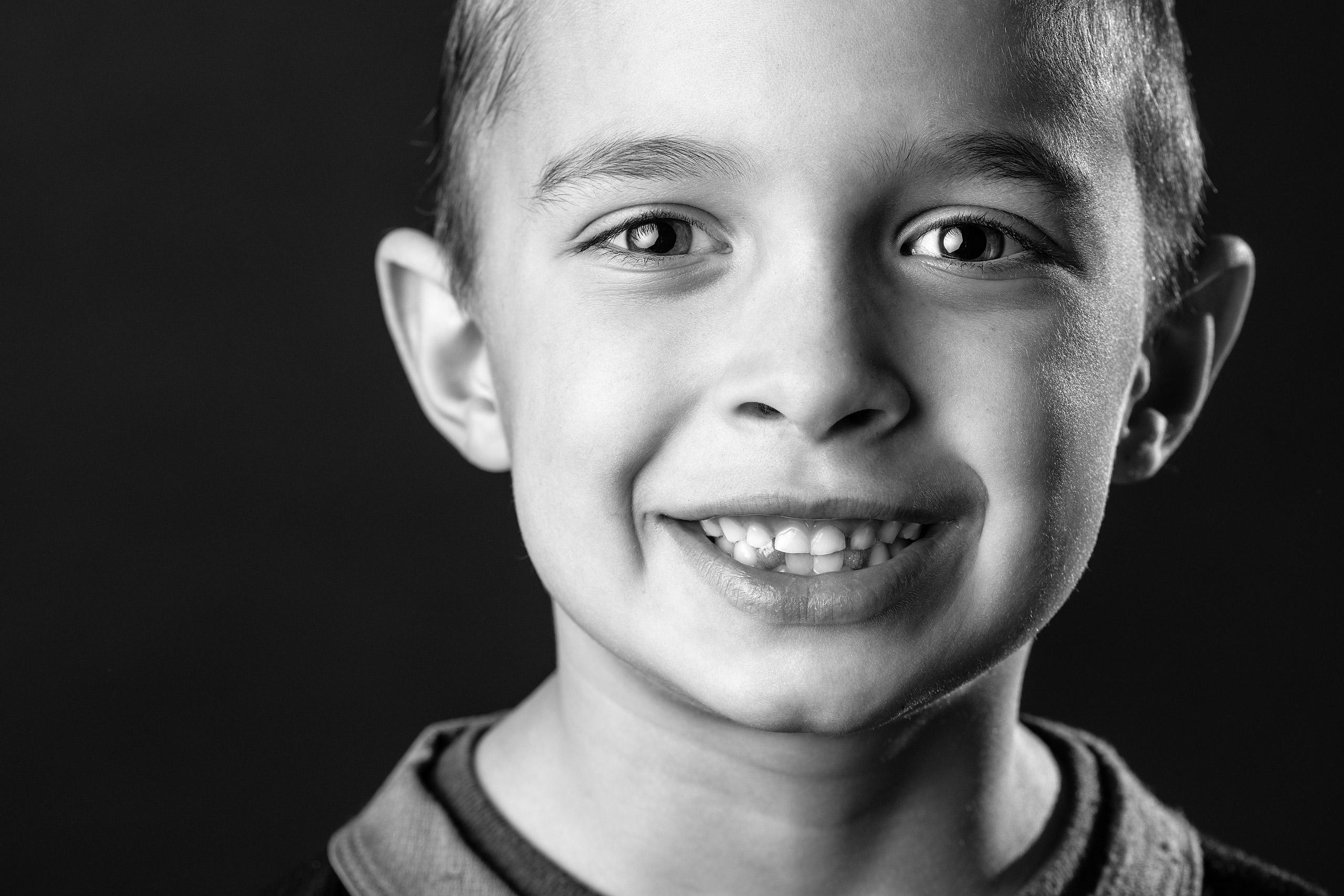 young boy smiling taken by family photographer sean leblanc