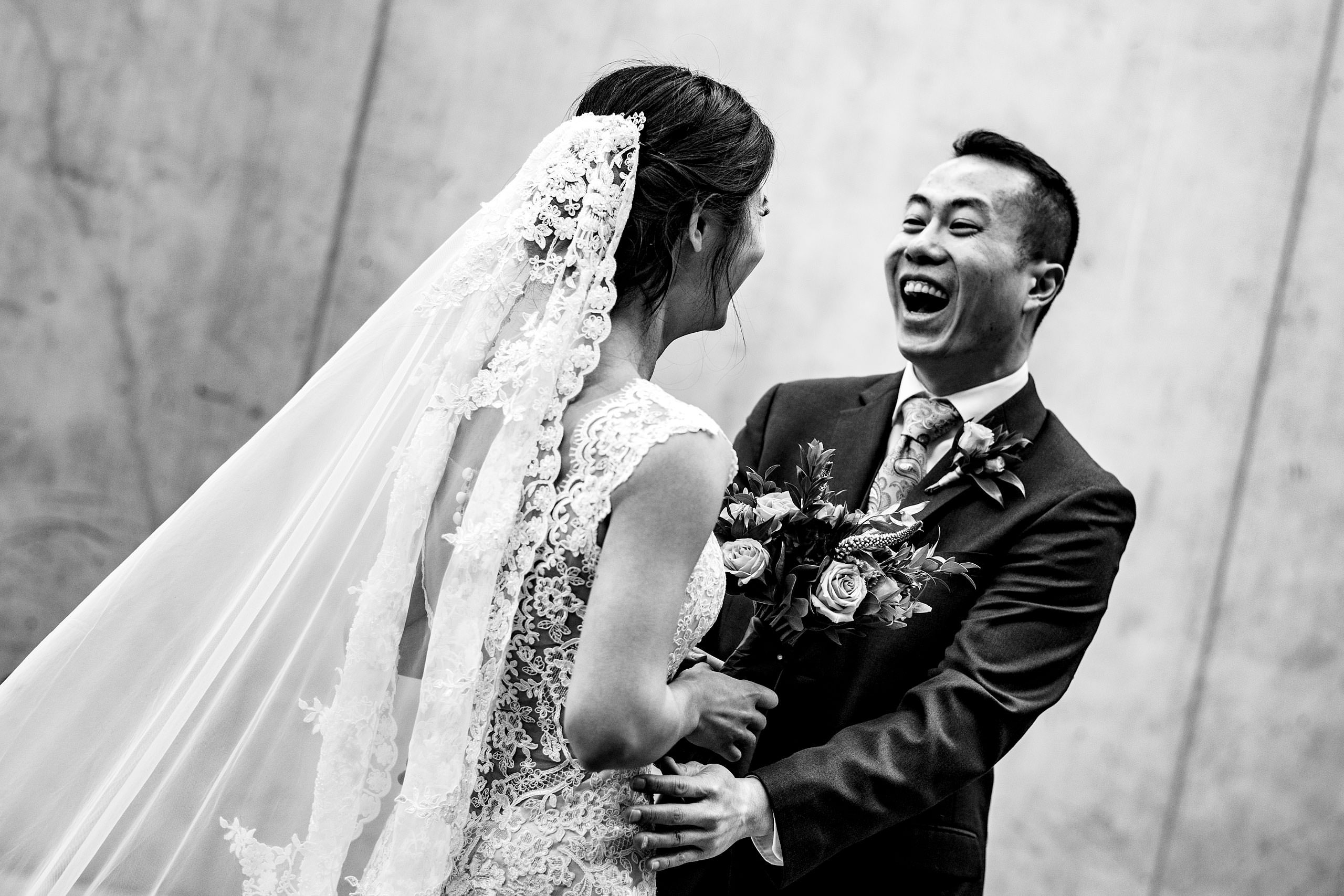 a groom and a bride at SAIT campus for their calgary lake house wedding by calgary wedding photographer sean leblanc photography