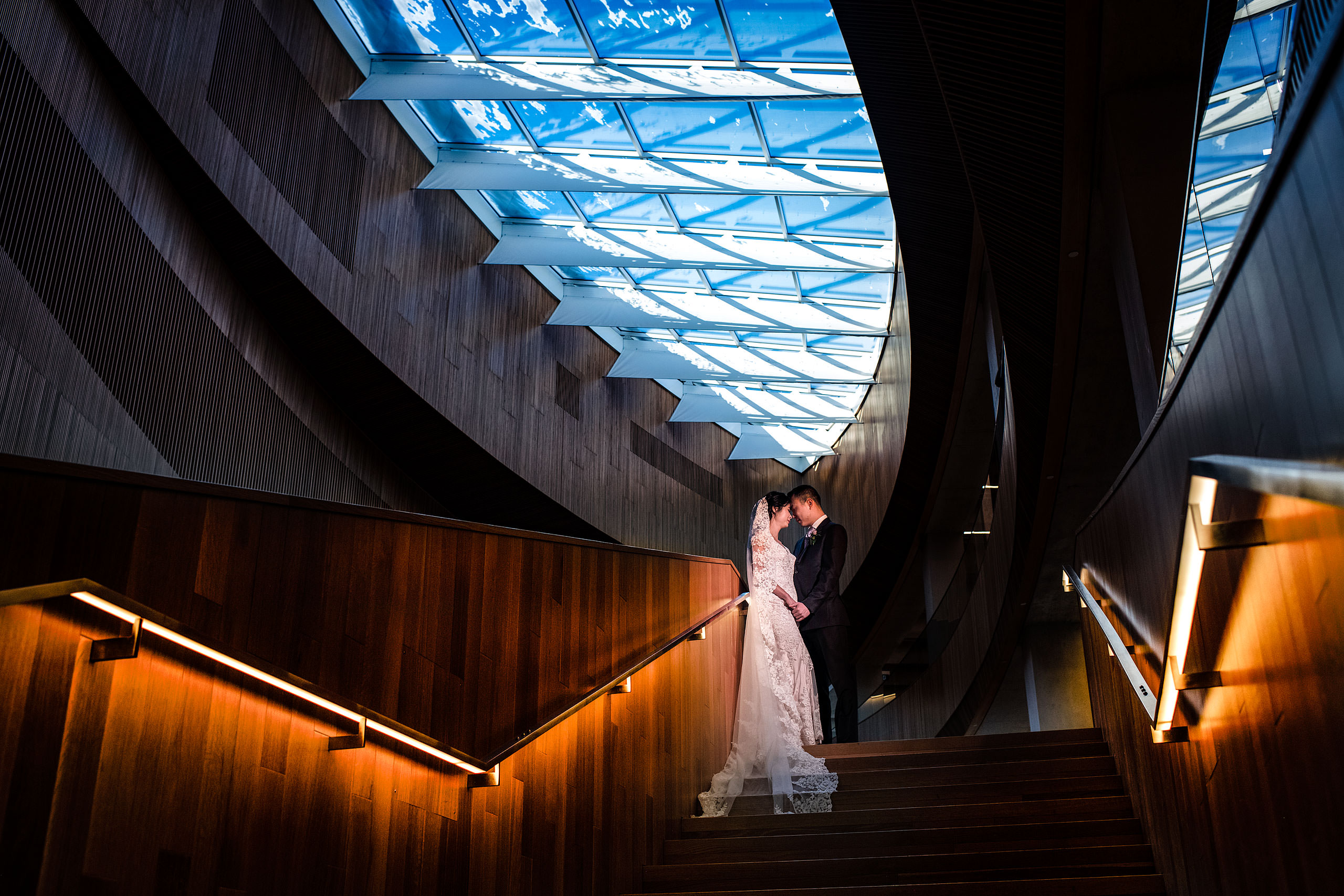 a creative bride and groom portrait at the calgary library for their calgary lake house wedding by calgary wedding photographer sean leblanc photography