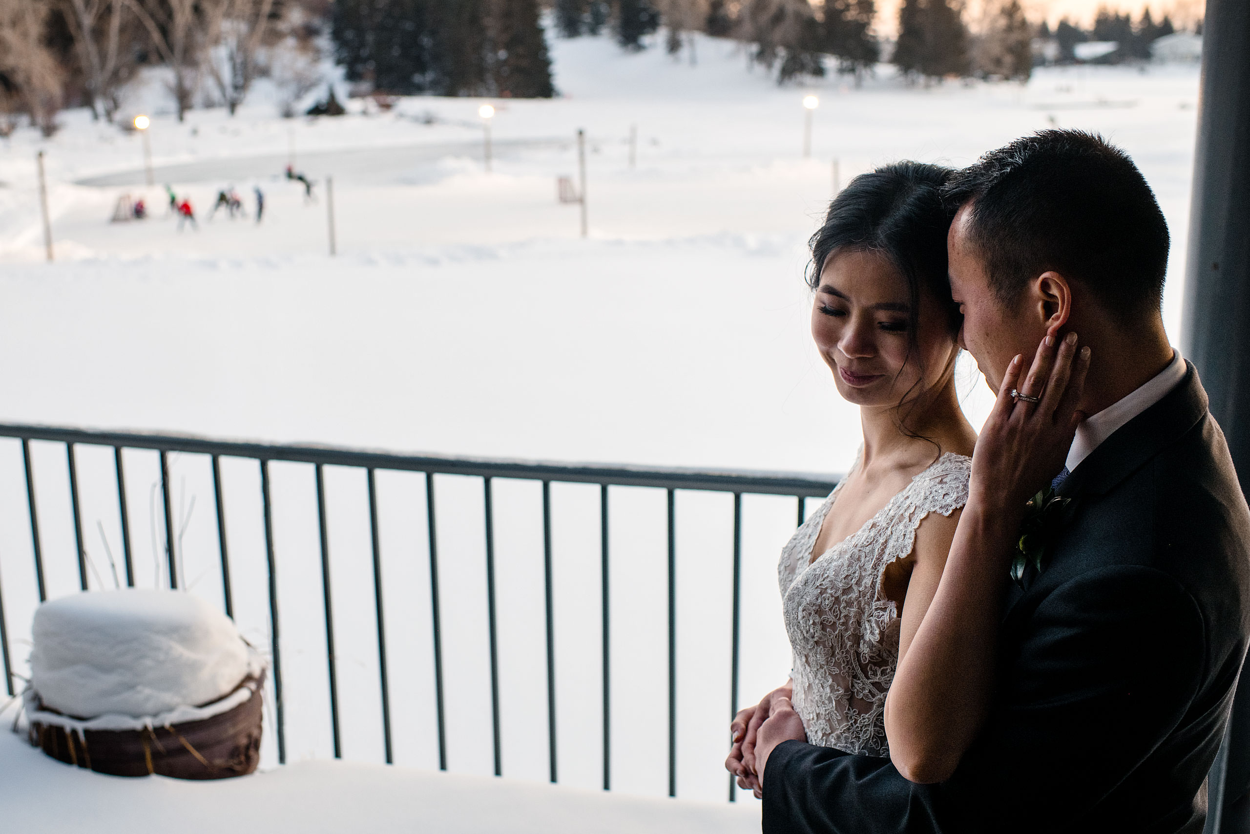 a bride and groom outside the lake house for their calgary lake house wedding by calgary wedding photographer sean leblanc photography