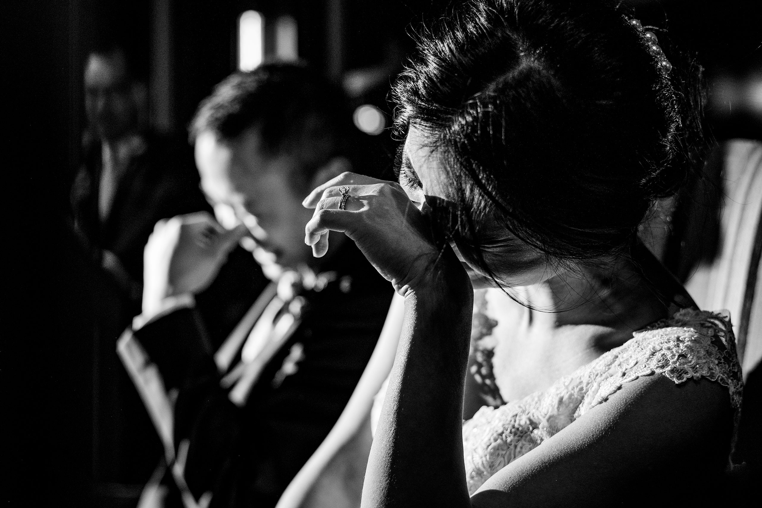 a bride and groom laughing during their reception at their calgary lake house wedding by calgary wedding photographer sean leblanc photography