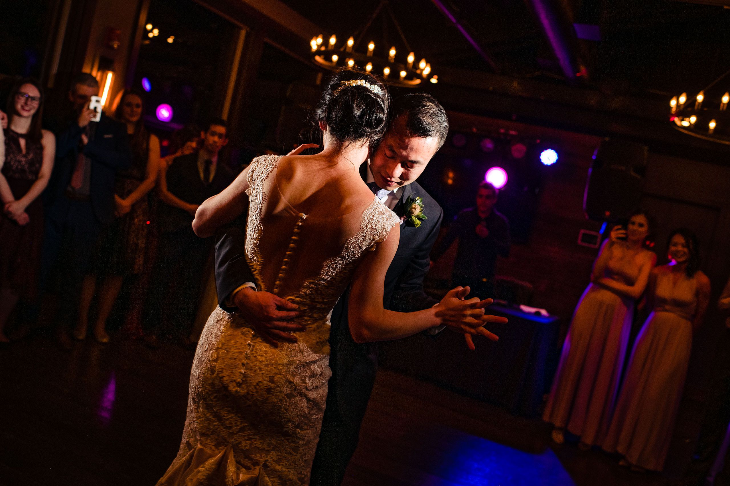 a bride and groom dancing during their calgary lake house wedding by calgary wedding photographer sean leblanc photography