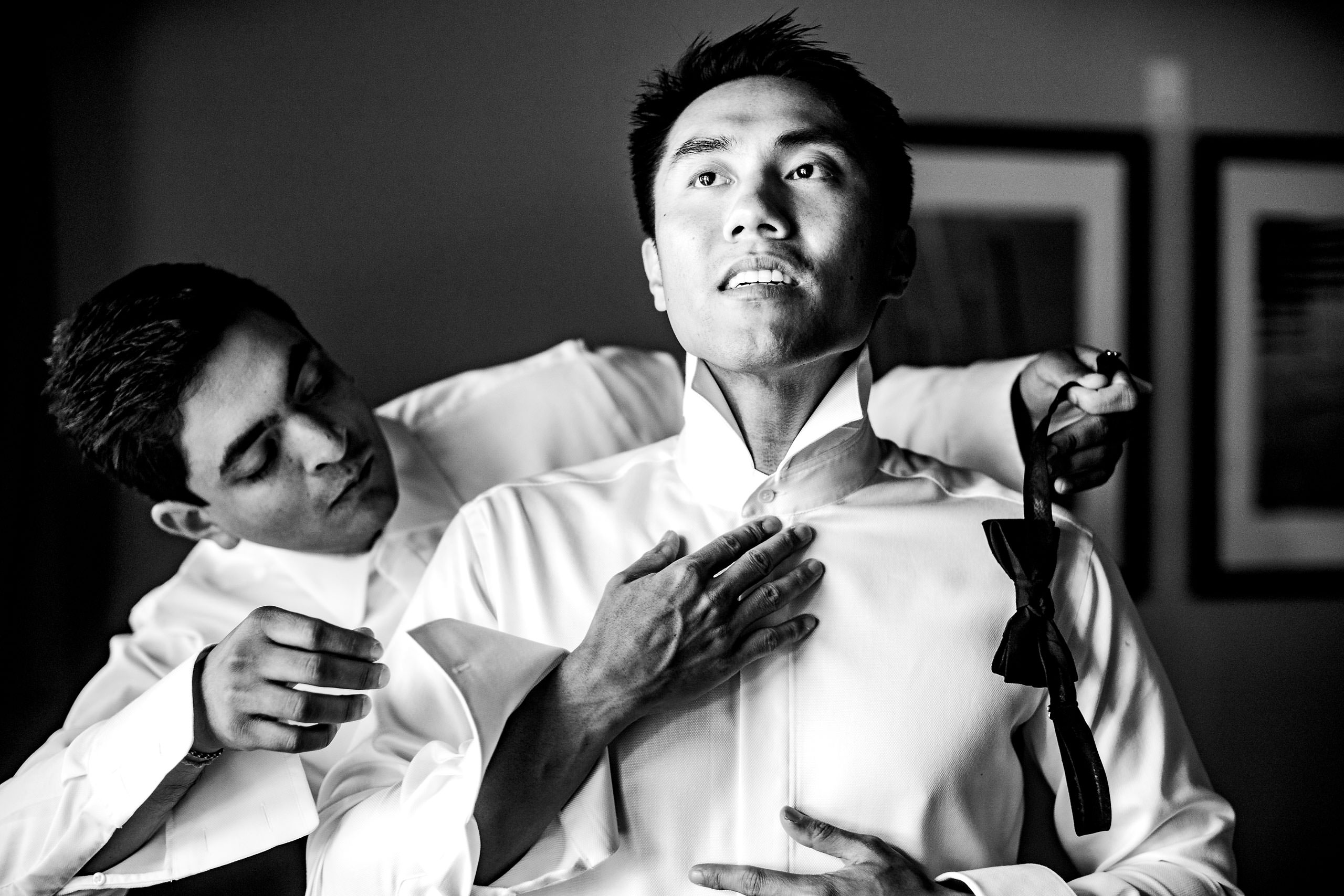 Groom getting ready by Carmel Valley Ranch Wedding Photographer Sean LeBlanc