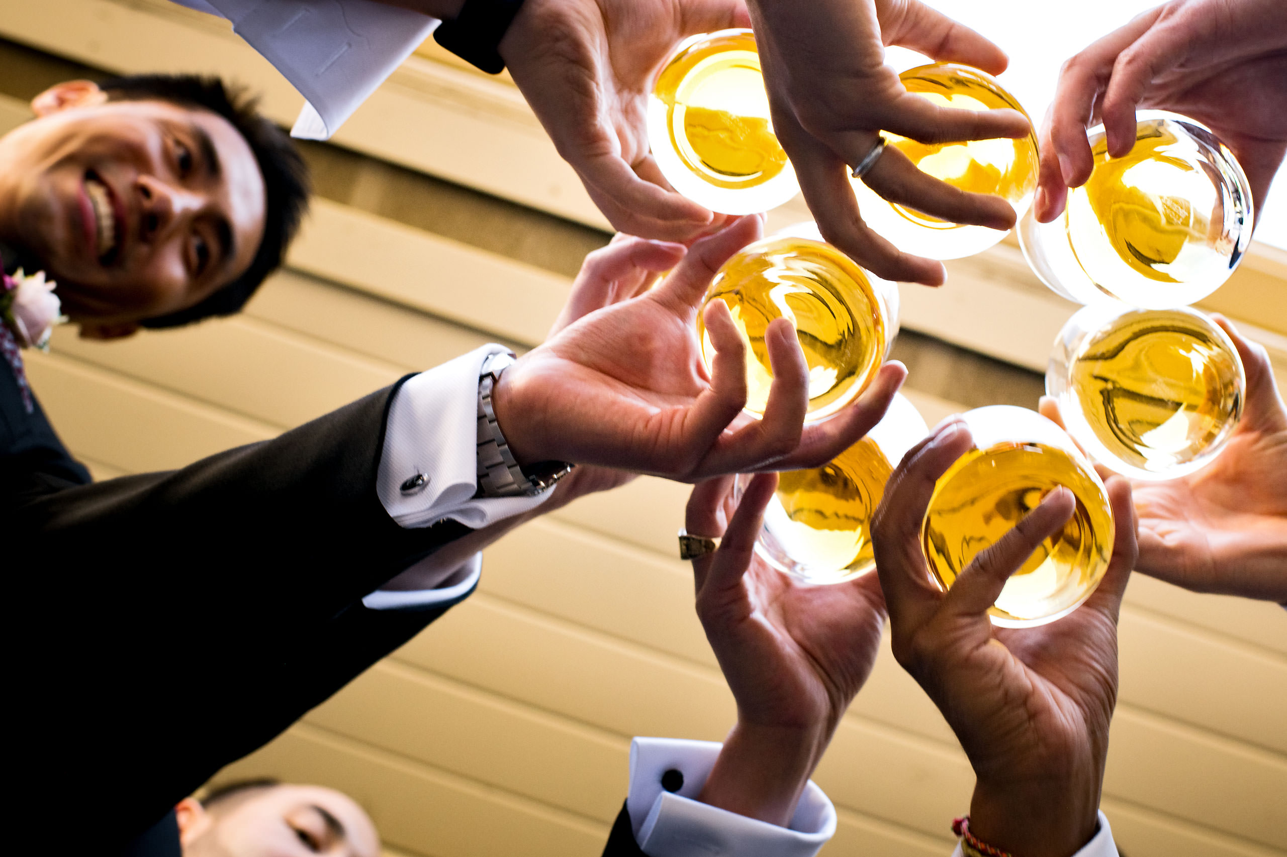 Groomsmen drinking whiskey by Carmel Valley Ranch Wedding Photographer Sean LeBlanc