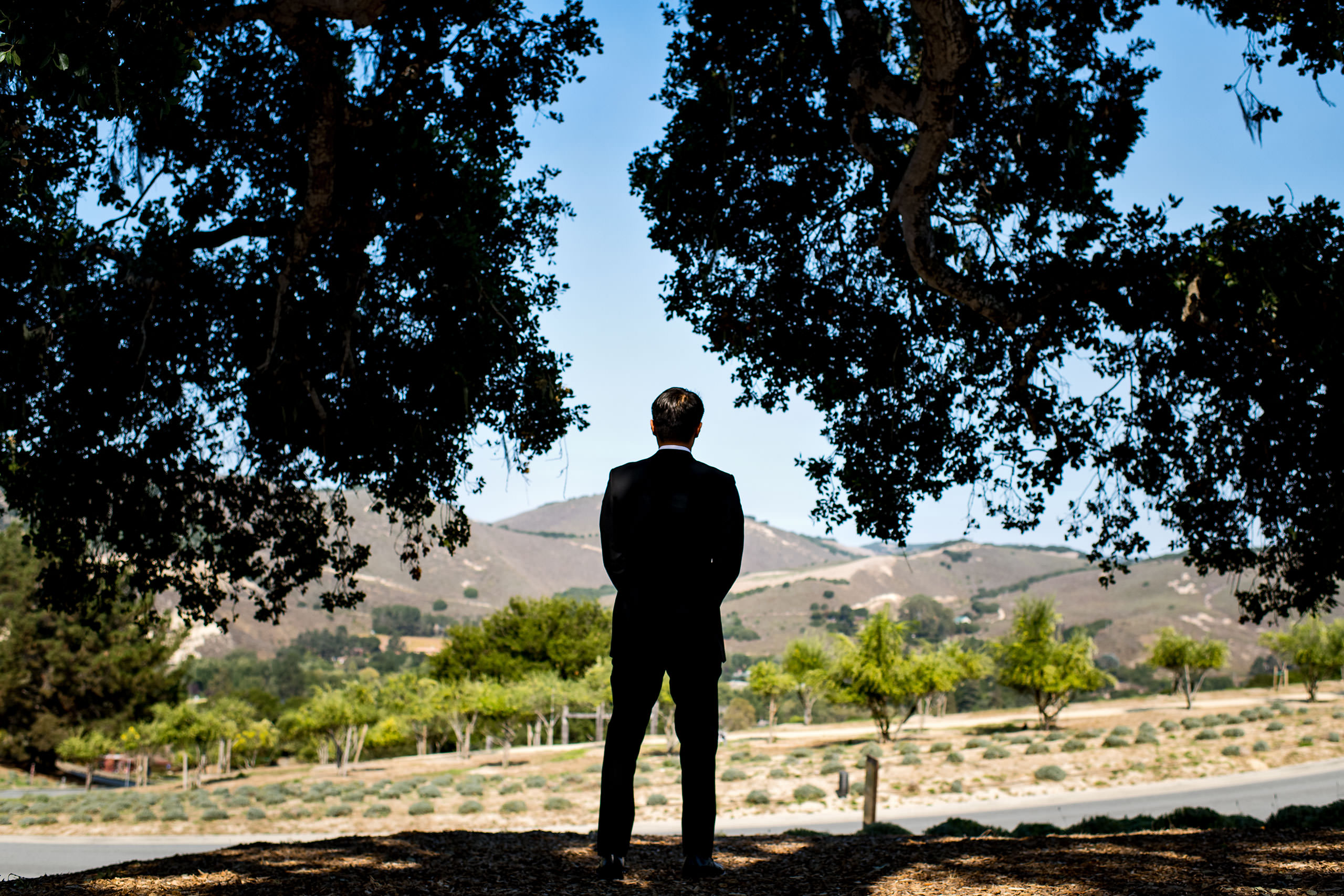 Groom standing by Carmel Valley Ranch Wedding Photographer Sean LeBlanc