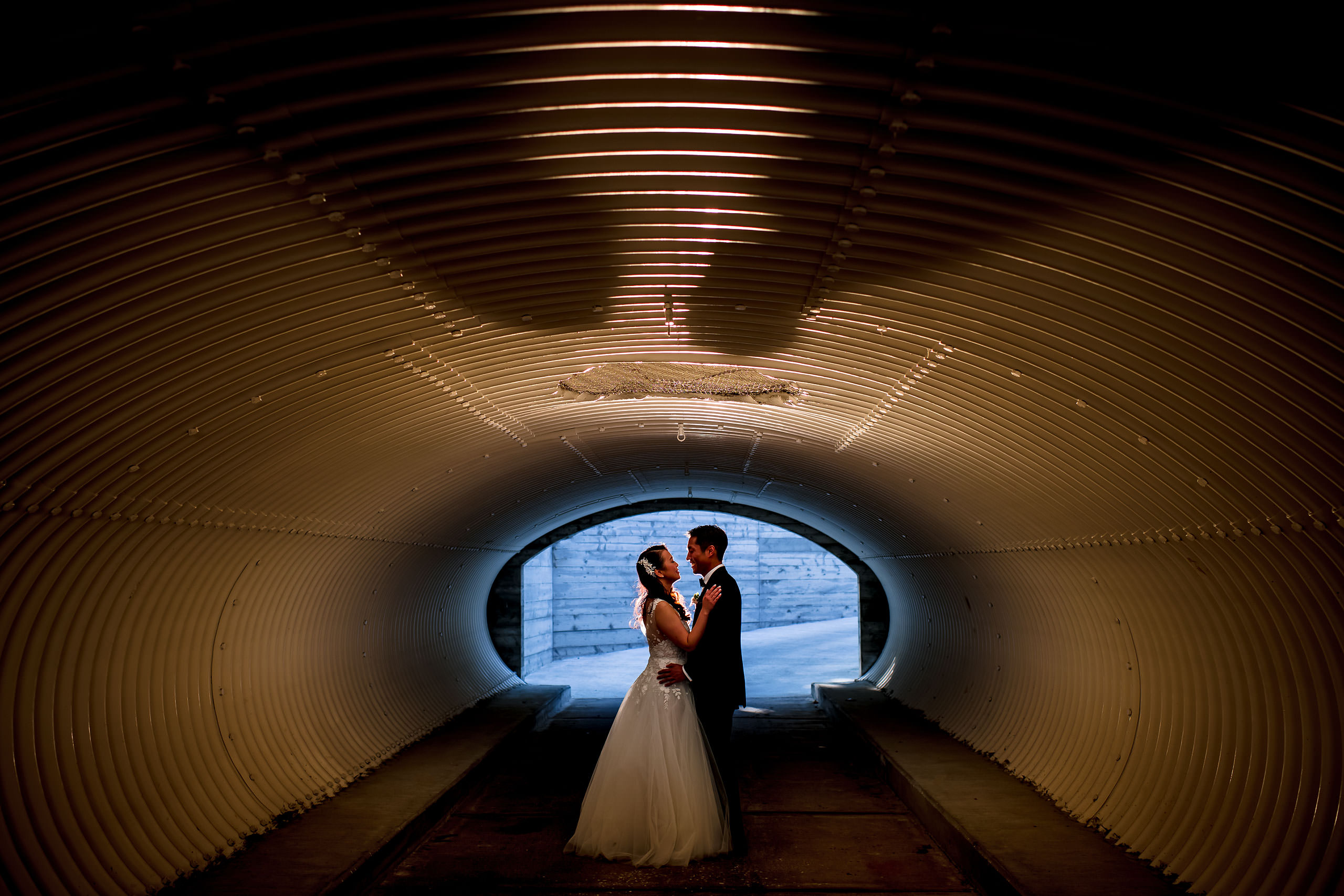 Bride and groom in a golf cart tunnel by Carmel Valley Ranch Wedding Photographer Sean LeBlanc