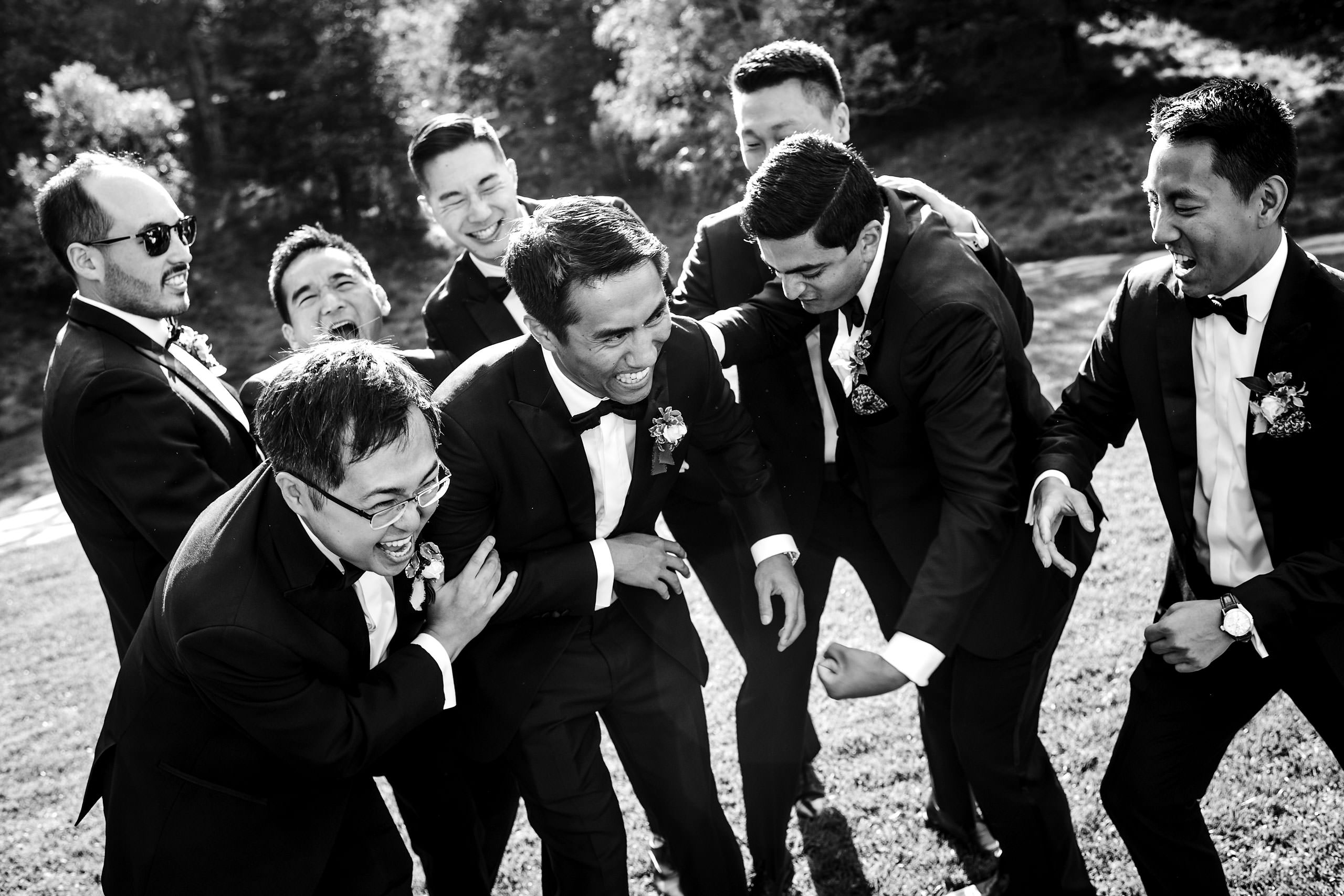 Groomsmen laughing by Carmel Valley Ranch Wedding Photographer Sean LeBlanc