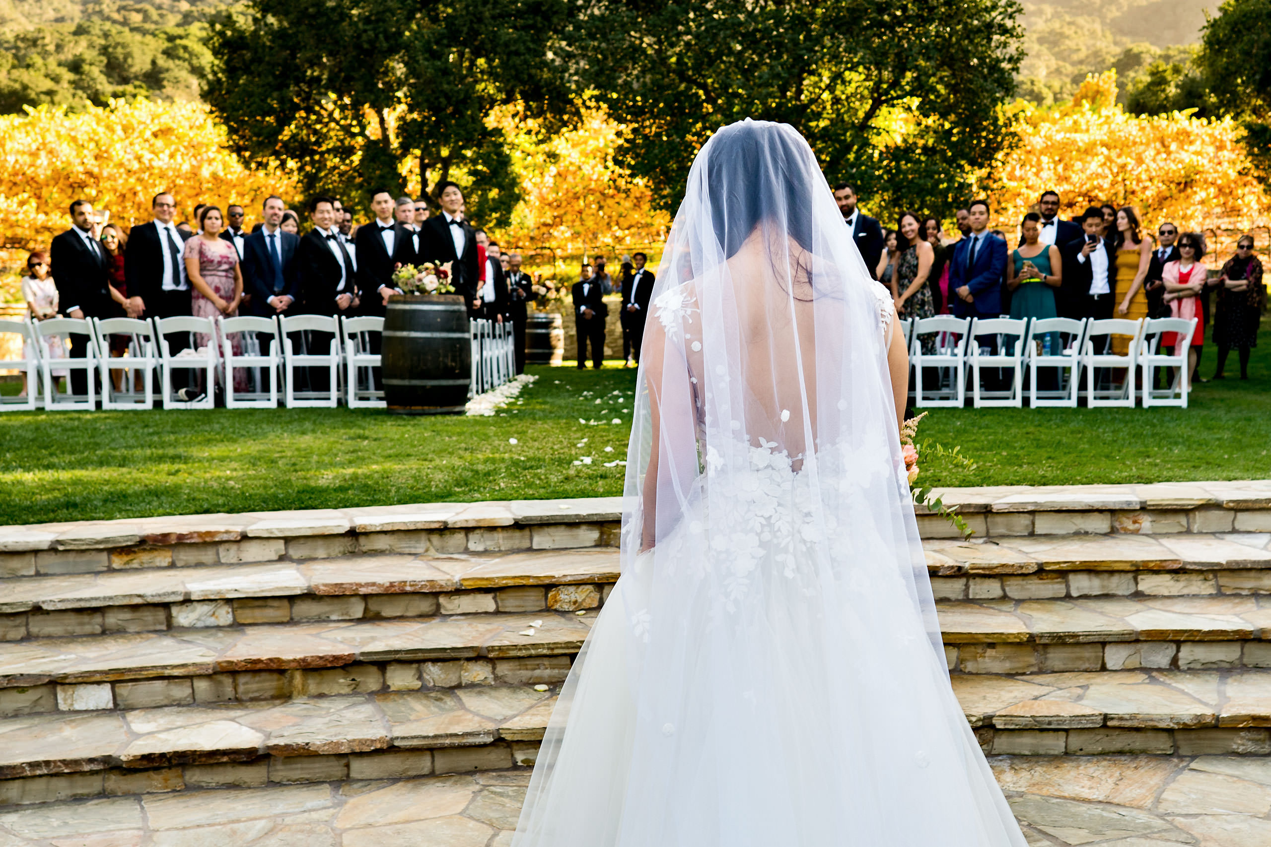 Bride walking down the aisle by Carmel Valley Ranch Wedding Photographer Sean LeBlanc