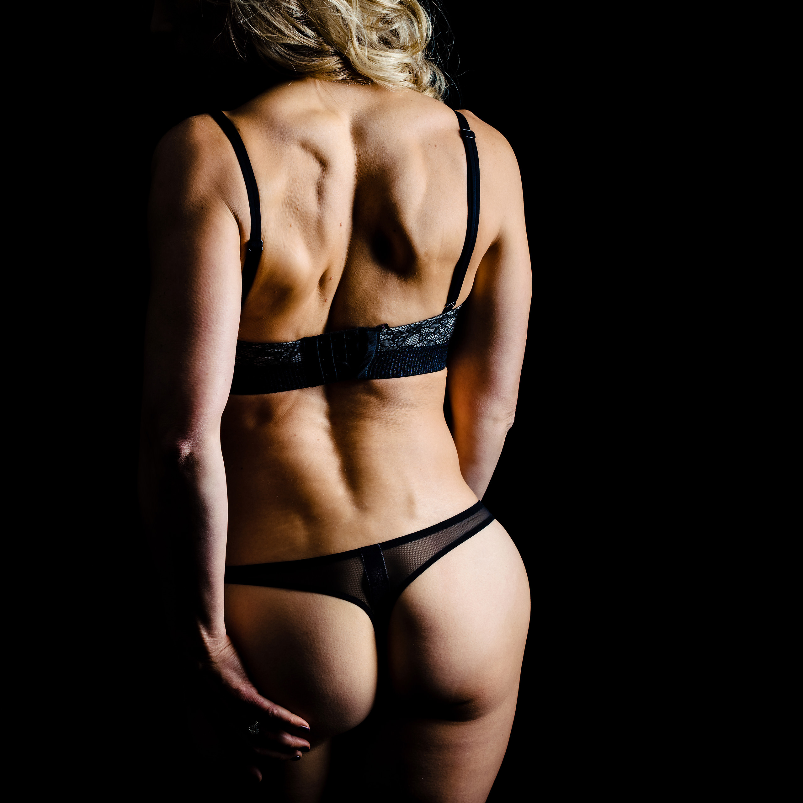 A woman in lingerie for shimmer boudoir experiences by sean leblanc photography
